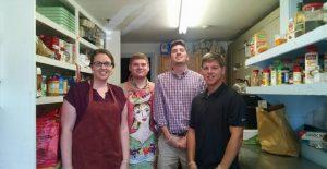 four volunteers in the food pantry
