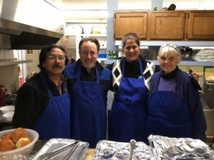 four volunteers in the kitchen from the bangor symphony orchestra