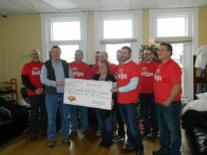 hannaford helps volunteers presenting a large check