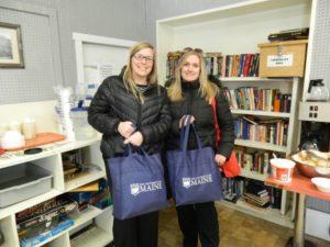 two volunteers donating needed supplies